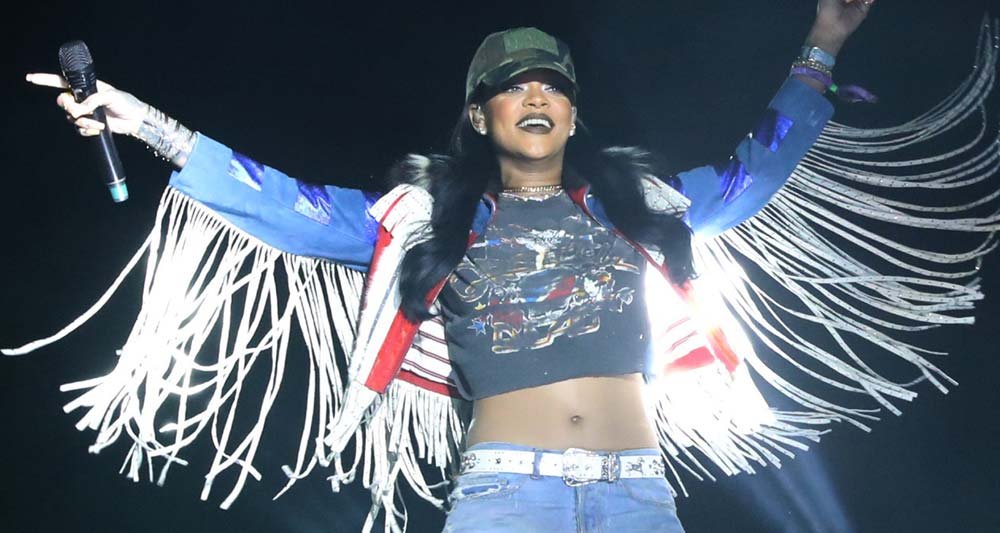 Rihanna on stage at Coachella sporting a baseball cap